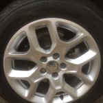 Repaired and painted Jeep alloy