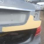 Repair in process with car body filler